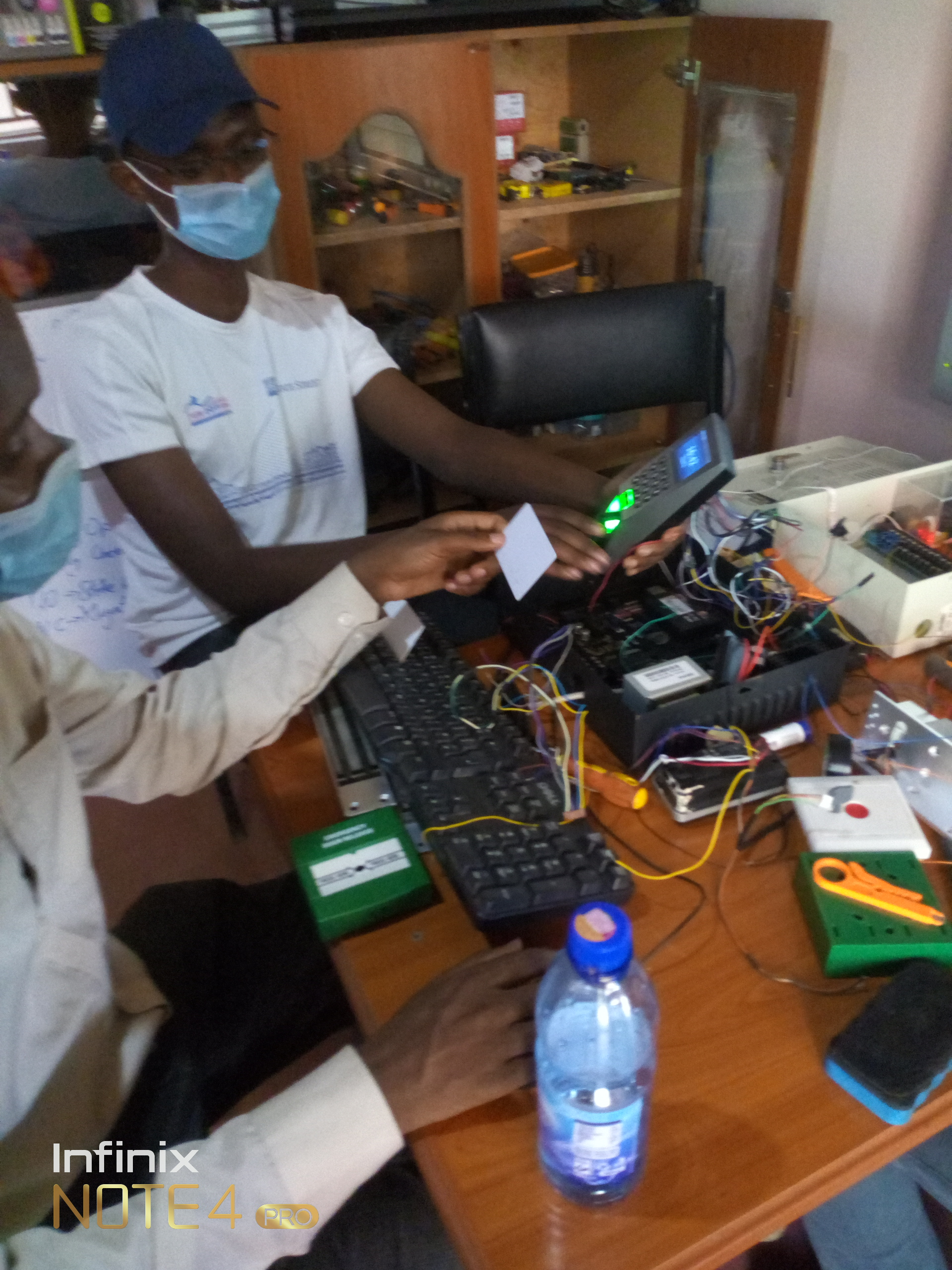 Trainees programming an access control device  during one of the training sessions