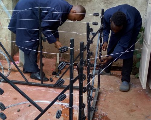 Trainees building a fence